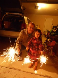 Lighting sparklers with daddy.