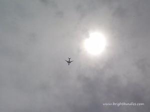 plane in overcast sky