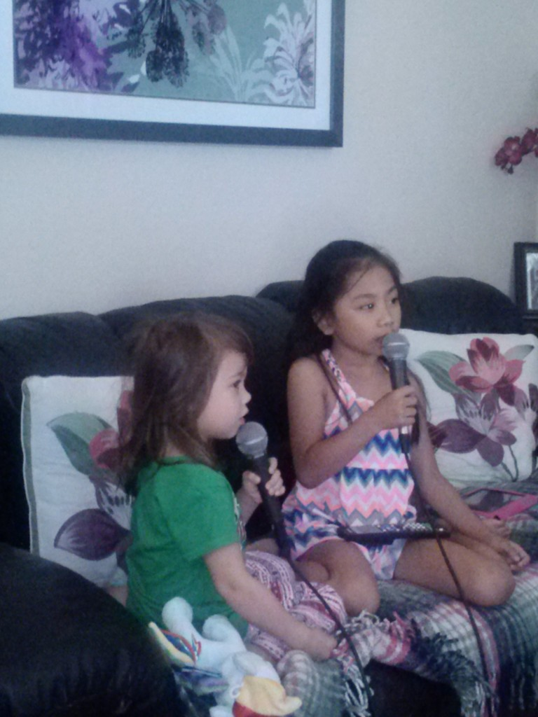 DD and friend singing Let It Go from the movie Frozen.