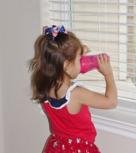 little girl drinking