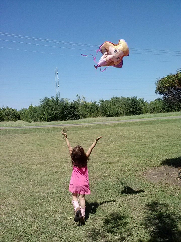 K catching the tails of the kite.