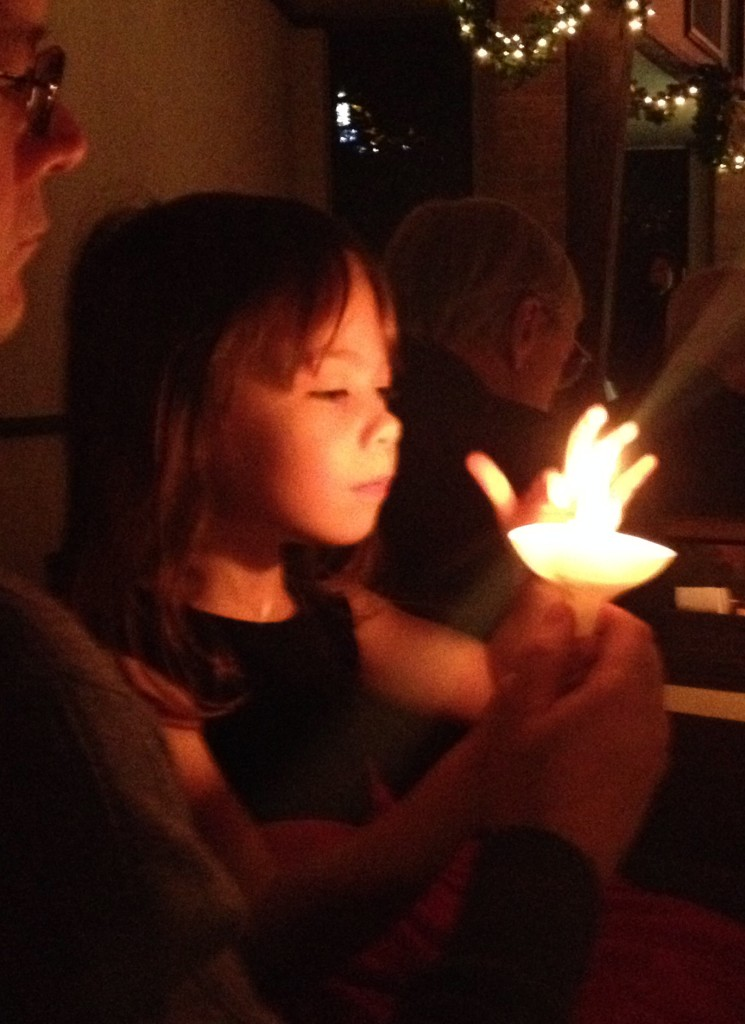 Candle-lighting in the church during the worship service.  Christmas Eve 2014