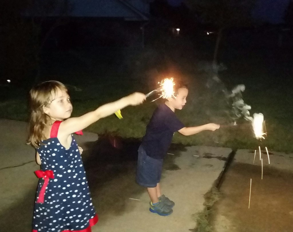 K and friend lighting up sparklers.