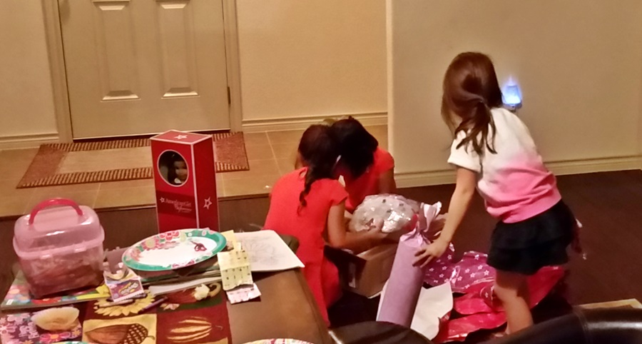 K is helping AC open her birthday gifts. :)